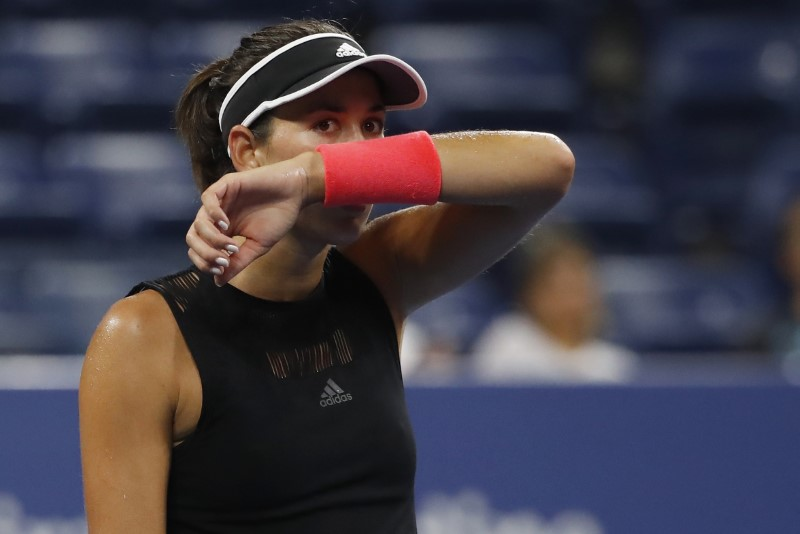 Muguruza stunned by qualifier Muchova at U.S. Open